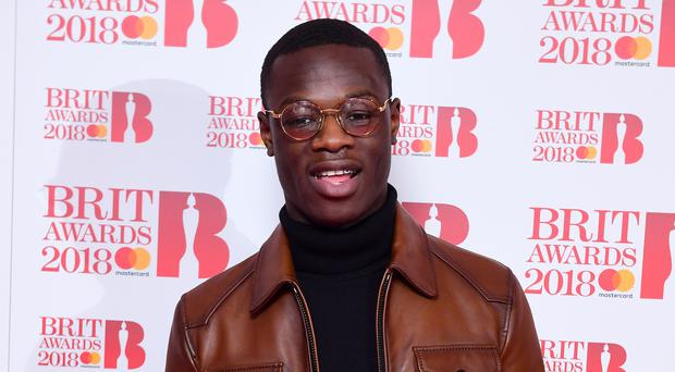 J Hus denies having a lock knife, without good reason or lawful authority (Ian West/PA)