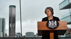 Prime Minister Theresa May delivers a keynote speech at the Waterfront Hall on July 20, 2018 in Belfast. (Photo by Charles McQuillan/Getty Images)