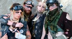 SAN DIEGO, CA - JULY 20: Cosplayers pose dressed as Mad Max characters outside San Diego Comic-Con on July 20, 2018 in San Diego, California. More than 100,000 are expected at the annual comic and entertainment convention. (Photo by Mario Tama/Getty Images)