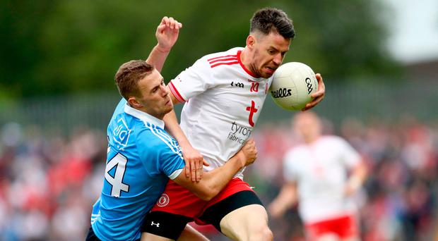 Gripping affair: Dublin's Paul Mannion clashes with Mattie Donnelly