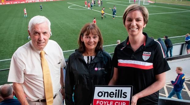 Team effort: Foyle Cup organiser Michael Hutton at the Brandywell on Saturday during Finals Day with two of the event's backers, Mary McFerran of Tourism NI and Orla Ward from tournament sponsors O'Neills
