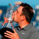 Sealed with a kiss: Open winner Francesco Molinari shows his joy at becoming first Italian to lift the Claret Jug trophy yesterday