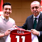 Controversial photo: Mesut Ozil presents Turkey president Recep Tayyin Erdogan with an Arsenal shirt