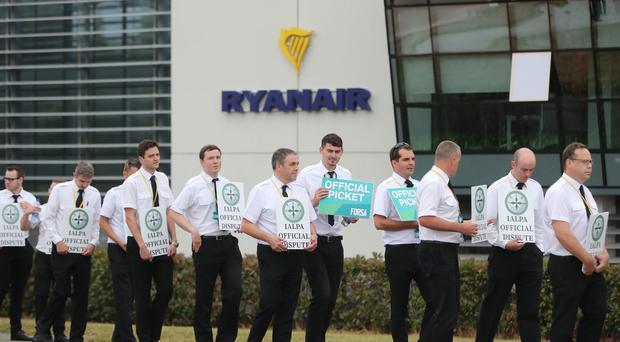 Ryanair pilots form a picket outside the company headquarters in Swords, Dublin (Niall Carson/PA)