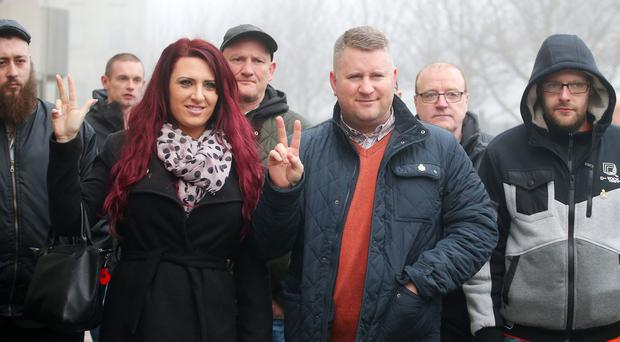 Britain First leader Paul Golding(centre) arrives at Belfast Magistrates Court, along with the deputy leader Jayda Fransen(left), where he was appearing after being charged with making a hate speech at Belfast City Hall last summer. Picture by Jonathan Porter/PressEye