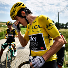 Burning issue: Geraint Thomas washes out his eyes after police spray lingered in the air