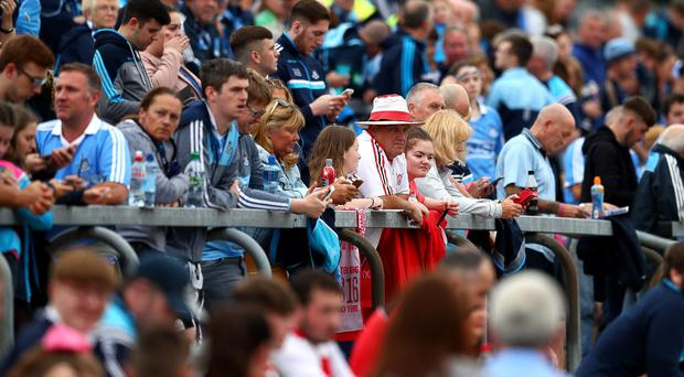Mixing it: Dublin and Tyrone fans