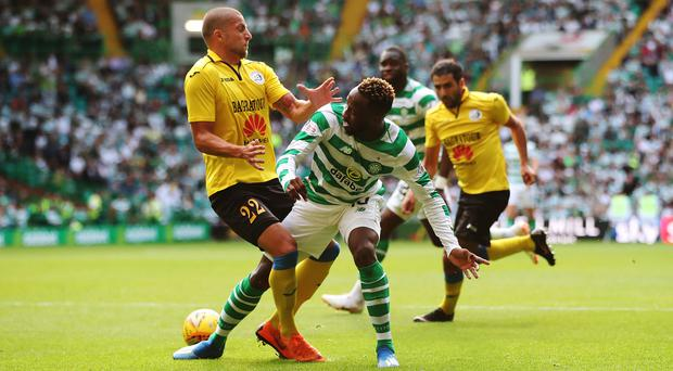 Early blow: Moussa Dembele will be out for up to three weeks after picking up a hamstring injury in Celtic's win over Alashkert