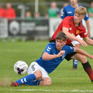 Glamour clash: Manchester United's George Walters challenges Rangers' Cole McKinnon in the SuperCupNI Junior section tie at Ballymena Showgrounds yesterday