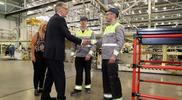 Chancellor Phillip Hammond meets apprentices during a visit to the Bombardier factory in Belfast (Brian Lawless/PA)
