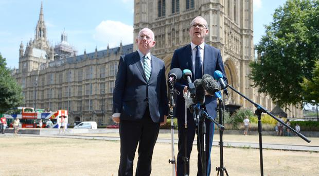 Justine Minister Charles Flanagan, left, with Irish Foreign Minister Simon Coveney in London (Kirsty O'Connor/PA)