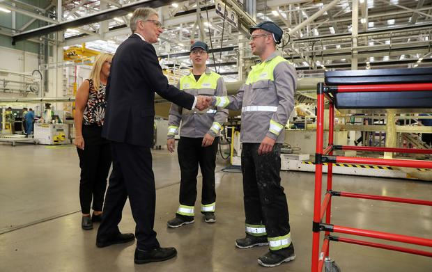 Phillip Hammond meets apprentices in Belfast (Brian Lawless/PA)