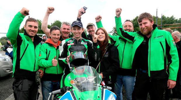 What a feeling: Derek McGee (centre) and his team celebrate winning the Irish Supersport and Supertwin Road Racing Championships at the 2017 Armoy Road Races