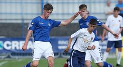 Glasgow Rangers' Cole McKibbon in action against Co Londonderry's Lee Harkin at the 2018 SuperCupNI.