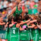 Day to remember: Ireland skipper Katie Mullan celebrates with her team-mates after defeating India