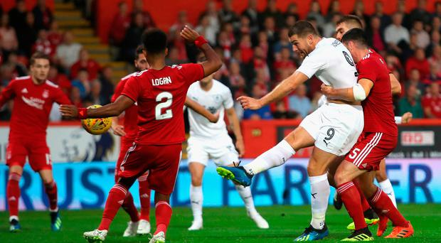 Crucial strike: Sam Vokes equalises for Burnley against Aberdeen at Pittodrie in the Europa League last night