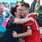 That's my boy: Co Down captain Jake Corbett gets a kiss from his proud mum
