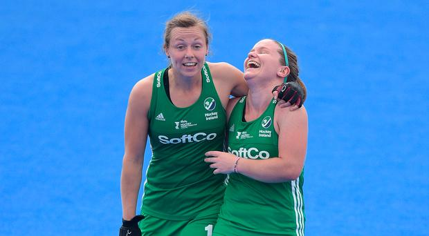 What a feat: Ulster duo Megan Frazer (left) and Shirley McCay after Ireland's historic 1-0 win over India in London yesterday which booked World Cup quarter-final spot