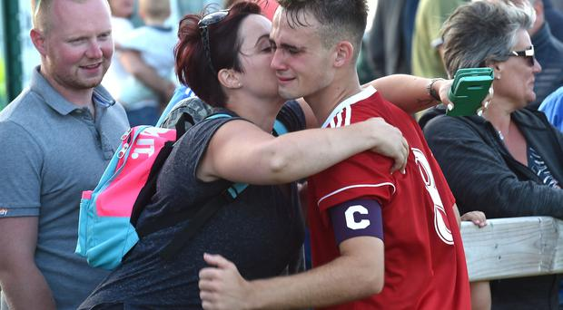26th July 2018 SuperCupNI 2018 Premier section semi final between Co Down and Club America at Riada in Ballymoney Co Down's captain Jake Corbett gets a kiss from a very proud mum Mandatory Credit: Stephen Hamilton /Presseye
