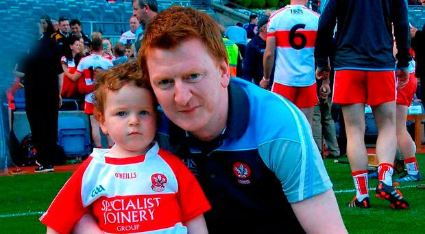 Future's bright: Ulster Council Provincial Hurling Development Officer Kevin Kelly and son Olly