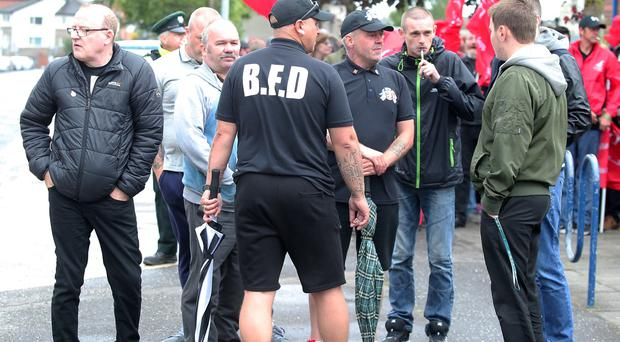 Members of Britain First gather at Ards Leisure Centre in Co. Down where they redirected supporters to another location for a private meeting. They were met by a counter protest and a small police presence. Picture by Jonathan Porter/PressEye