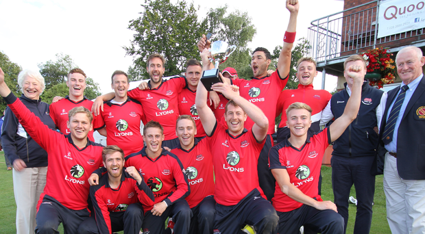 Bowled over: T20 Cup winners Waringstown joined by Dame Mary Peters who made the trophy presentation and whose Trust benefitted as charity partner