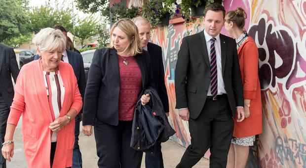 Secretary of State Karen Bradley MP with Cathedral Youth Club founder Jeanette Warke, Gregory Campbell MP and Gary Middleton MLA in the Fountain Estate. Picture Martin McKeown. Inpresspics.com. 30.07.18