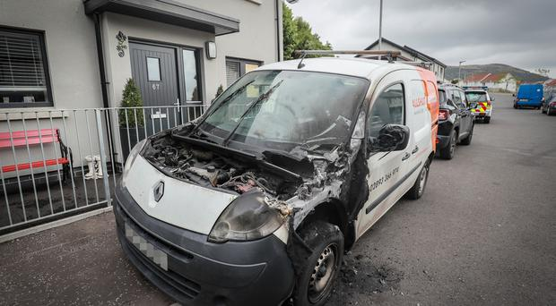 The burnt out van on Ballysillan Avenue, in Belfast