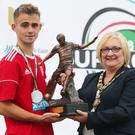 Jake Corbett collects the Premier Section Player of the Tournament award at this year's SuperCupNI.