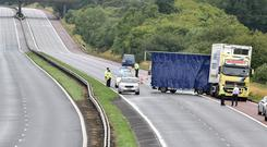 Police at the scene of a serious crash on the Belfast bound lane of the M1 on Wednesday, August 1. Photo by Tony Hendron/Tonpixnews.