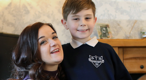 Martina McMahon with her son Alex, who helps care for his younger siblings