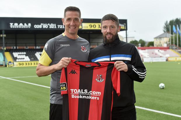 Crusaders new signing Rory Patterson pictured at Seaview with manager Stephen Baxter after signing a one year deal from Derry City. Mandatory Credit: Stephen Hamilton /Inpho