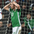 Corry Evans reacts to seeing controversial penalty awarded in the World Cup play-off against Switzerland.