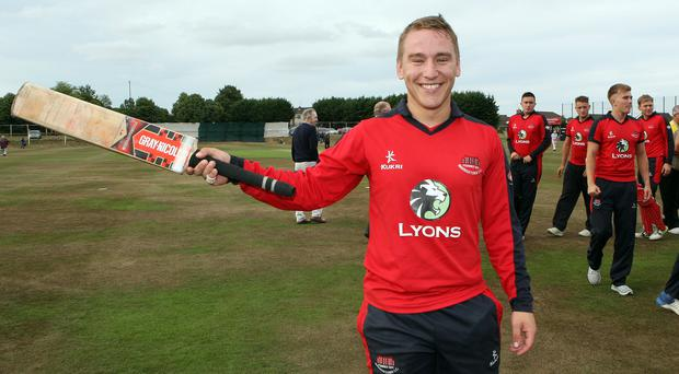 Hot form: Waringstown ace Adam Dennison is all smiles after his 145 not out in last week's Challenge Cup final