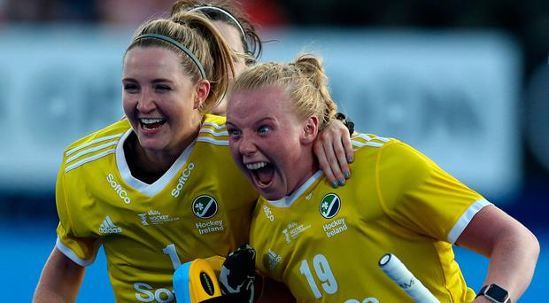 Ireland's goalkeeping great Ayeisha McFerran (right) is congratulated by Grace O'Flanagan after her shoot-out heroics.