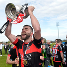 Crusaders skipper Colin Coates lifts title trophy last season... now it starts all over again