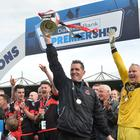 Stephen Baxter lifts the Gibson Cup after Crusaders clinched the title on the final day last season