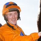 High note: Billy Lee, alongside Nessun Dorma, celebrates winning the Guinness Handicap at the Galway Festival yesterday