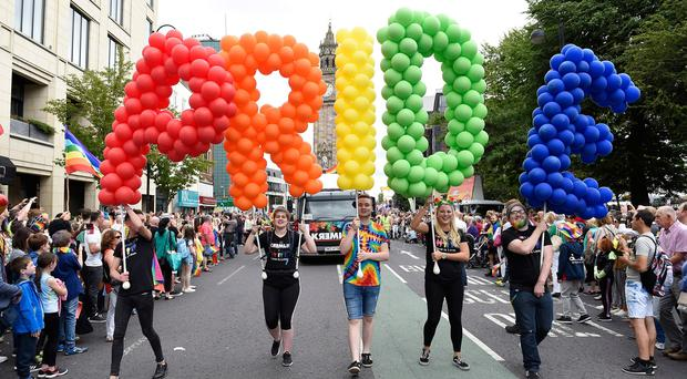 People taking part in the Belfast Pride parade set off from Custom House Square in central Belfast. Michael Cooper/PA Wire