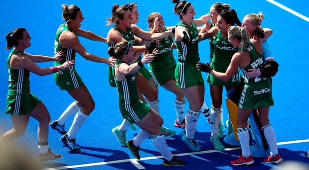 Ireland's Ayeisha McFerran (far right) celebrates with teammates after winning the shootout to win the match during the Vitality Women's Hockey World Cup Semi Final match at The Lee Valley Hockey and Tennis Centre, London. Steven Paston/PA Wire