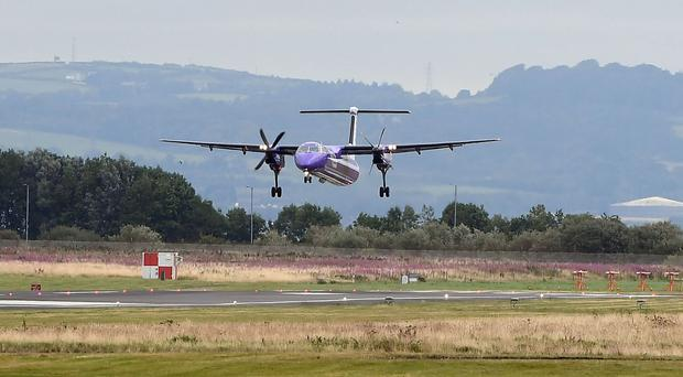 A Flybe flight from Scotland landing with one engine at Belfast City Airport this morning (right engine, looking a photo) - An emergency response sprung into action at Belfast City Airport this morning.