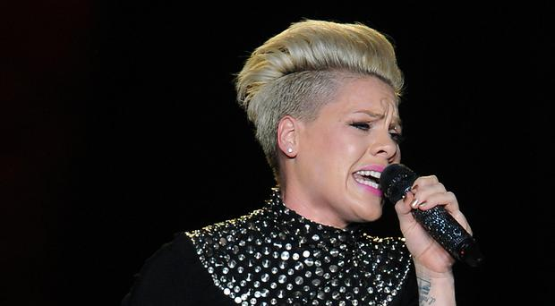 Pink has been diagnosed with a gastric virus (Joe Giddens/PA)
