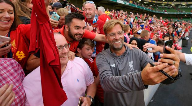 Liverpool manager Jurgen Klopp takes a selfie with fans after his side's friendly at Dublin's Aviva Stadium on Saturday.