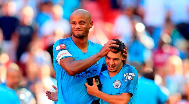 Flying start: Vincent Kompany congratulates Brahim Diaz after Manchester City's Community Shield triumph at Wembley