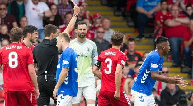 Rangers Alfredo Morelos is shown a red card during the Scottish Ladbrokes Premiership match at Pittodrie.