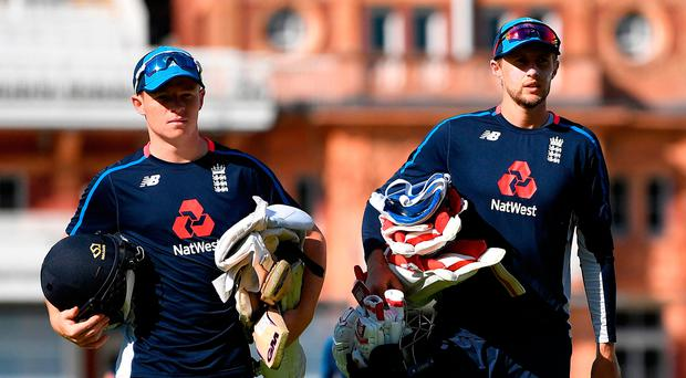 New kid: Ollie Pope (left) has been backed to shine by England skipper Joe Root (right)