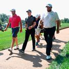 Striding on: Jon Rahm, Rory McIlroy and Shane Lowry during practice round ahead of the US PGA