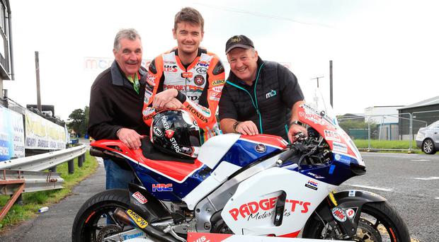 Main man: Robert Graham, chairman of the Dundrod & District Motorcycle Club, Isle of Man rider Conor Cummins and race sponsor Gerard Rice, Around a Poun