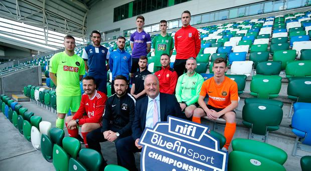 Big kick-off: Bluefin Sport Managing Director Steve McGuinness joins representatives of all 12 clubs at Windsor Park last night ahead of the Bluefin Sport Championship which starts tomorrow
