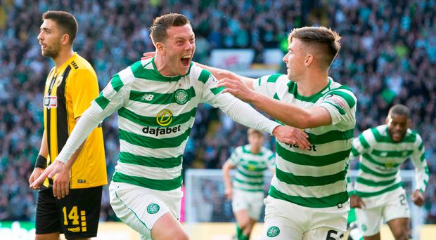 First blood: Celtic's Callum McGregor (left) celebrates scoring with Kieran Tierney